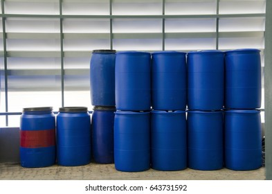 Stack of blue gallons at industry or factory