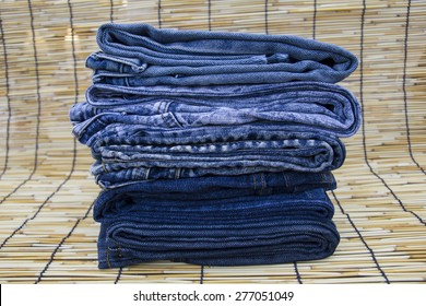 Stack of blue jeans denim discount sale sell second hand