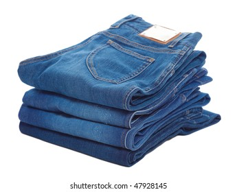 Stack of blue jeans a white background