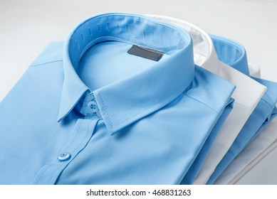 Stack of blue and white shirt closeup