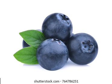stack of blueberries with green leaves isolated on white background