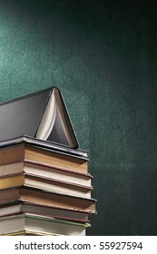 stack of book in front of the board