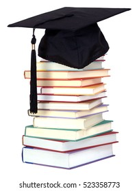 stack of book and graduation cap on white