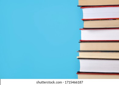 A stack of book on blue background with copy space.