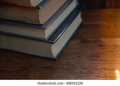 Stack book on wood table.