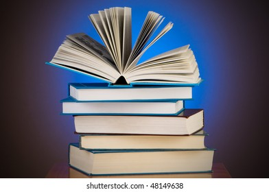 Stack of books against gradient background