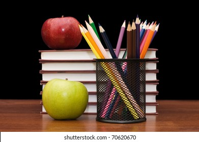 Stack of books and apple on white background