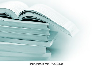 Stack of books in blue toned