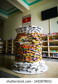 Stack of books circle shaped like a tower in the library, Bishkek, Krygyzstan, 08.06.2019