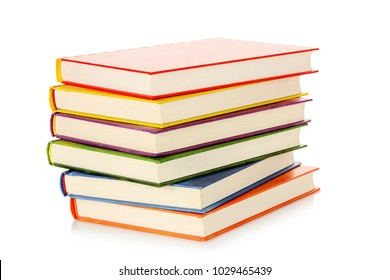stack of books with colorful covers isolated on white
