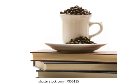 Stack of books and a cup of coffee