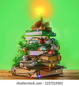 a stack of books decorated with New Year and Christmas decorations