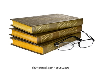 Stack  books and glasses on white background.