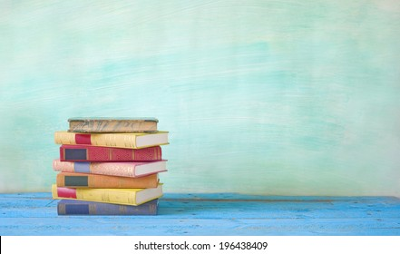 stack of books, grungy background, free copy space