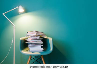 A stack of books in the interior in a minimalist style. Monocolor. The concept of reading, education, buying books. Copy space