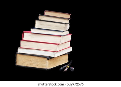 Stack of books isolated on black background.