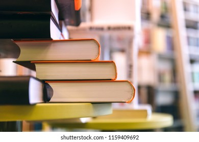 A stack of books in the library. Beginning of the school year, how to prepare