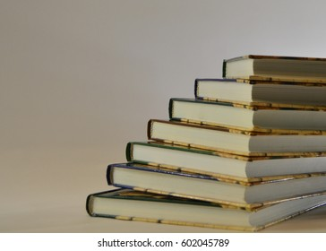 A stack of books lies on a white background