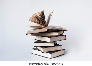A stack of books lying on a white background, learning, education, study