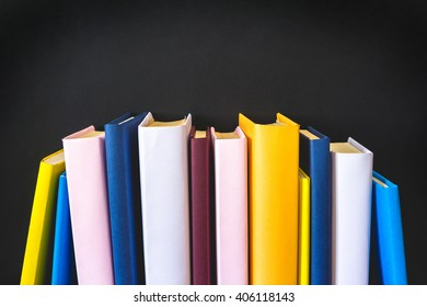Stack of books on black background