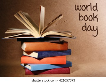 Stack of books on brown background. World Book Day poster