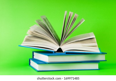 Stack of books on the color background