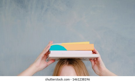 stack of books on female head. Cute and funny education concept