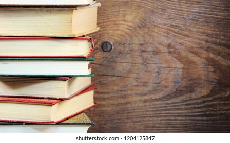 Stack of books on old wood background. Reading concept.
