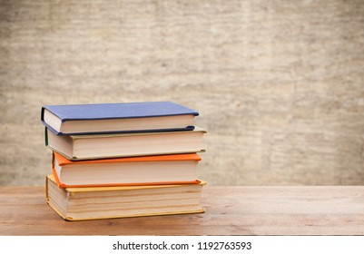 Stack of books on table at library