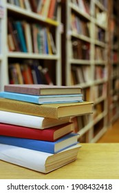 Stack of books on the table in library