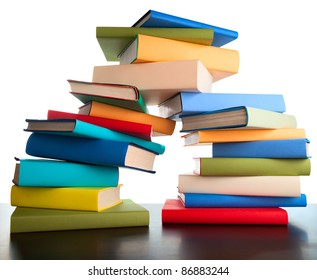 stack of books on white background colorful textbooks on pile
