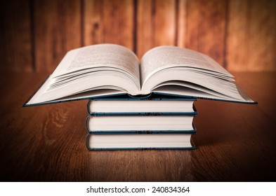 stack of books on a wood background