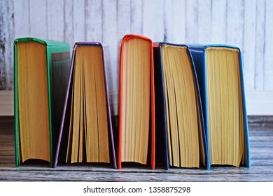 Stack of books on a wooden background.Education.