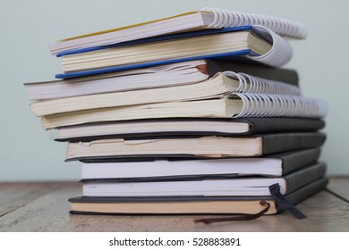 stack books on a wooden deck background