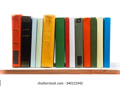 Stack of books on wooden shelf isolated on white background. Back to school. Copy space for text