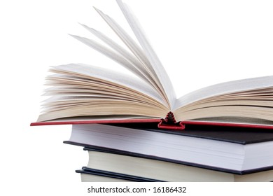 Stack of books with one left open