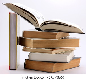 stack of books with open book and the stand of books isolated on white background