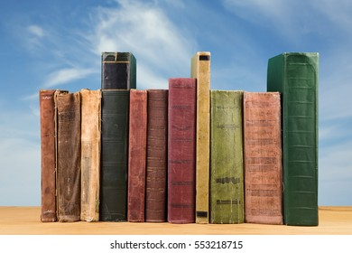 stack of books over the natural background