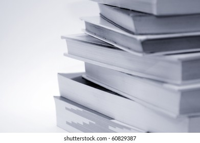 Stack of books over a white background