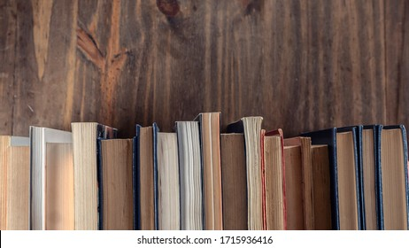 Stack of books over wooden table. Library, Read. Edication. Literature.