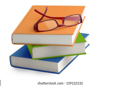 stack of books with a pair of eyeglasses on top