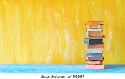 Stack of books, panorama format with large copy space. Reading, education, literature, learning, book fair concept or mock up