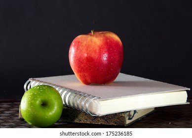 Stack of books and red apple,learning objects education concept