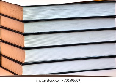 A stack of books side view
