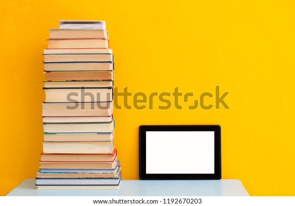 Stack Books Versus Kindle Tablet Reading Stock Photo (Edit