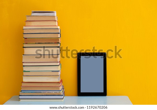 Stack Books Versus Kindle Tablet Reading Stock Photo (Edit Now
