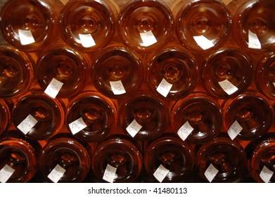 stack of bottles bottom side forward