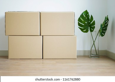 Stack of boxes as moving to new house concept