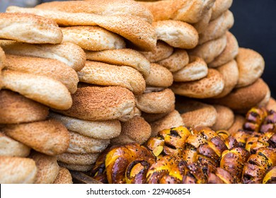 Stack of bread and rolls on display on cart of street vendor in the Middle-East