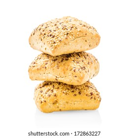 Stack of breads with seeds isolated on white background.